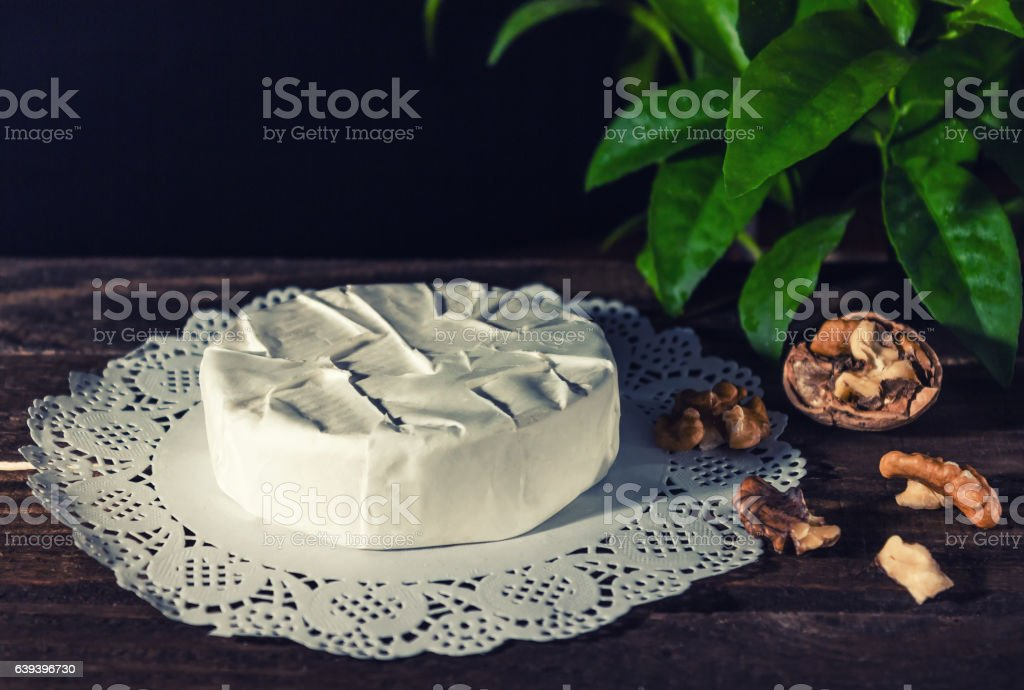 Camembert with noble white mold. Exquisite cheese. stock photo