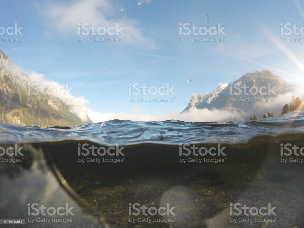 Camera above and underwater in a Traunsee lake stock photo