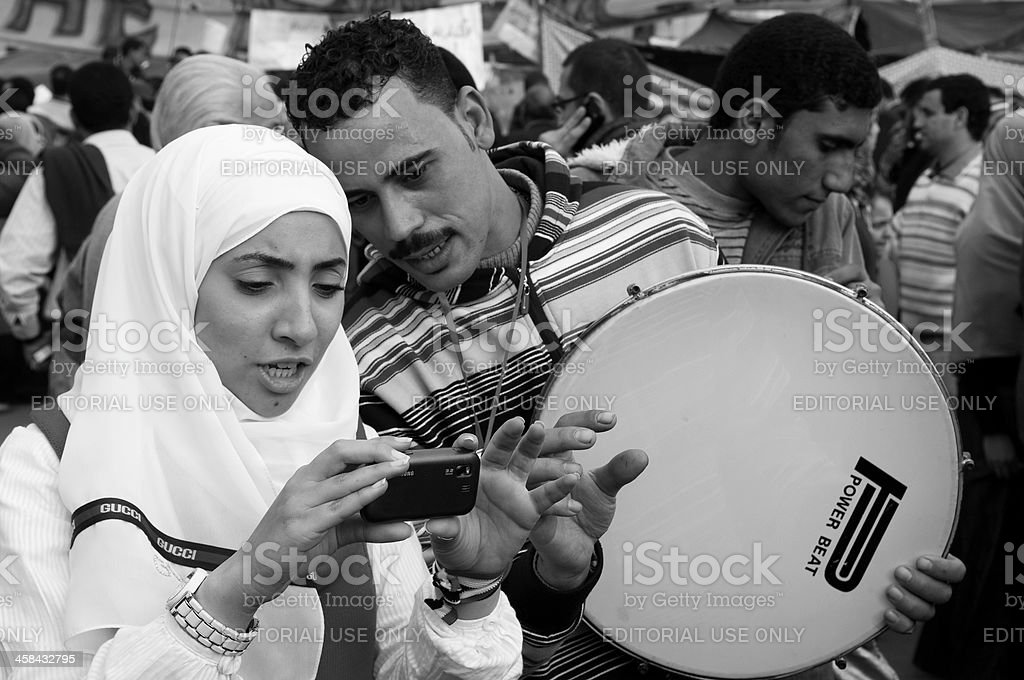 Camera and drum in Cairo's Tahrir Square royalty-free stock photo