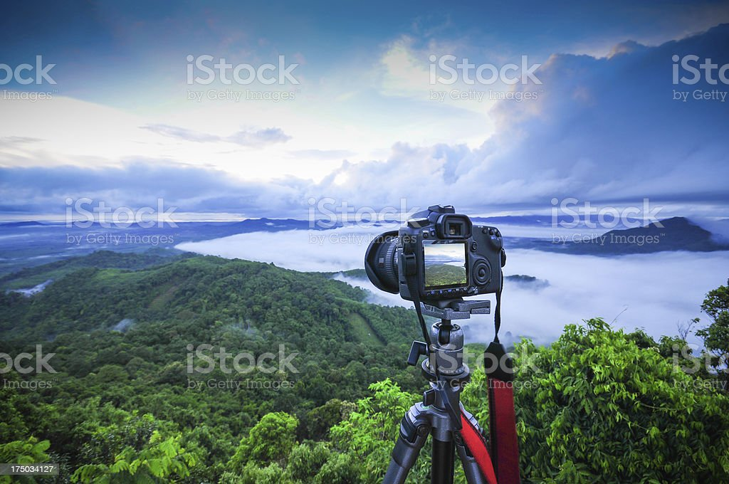 Camera and lens taking photograph in morning time stock photo