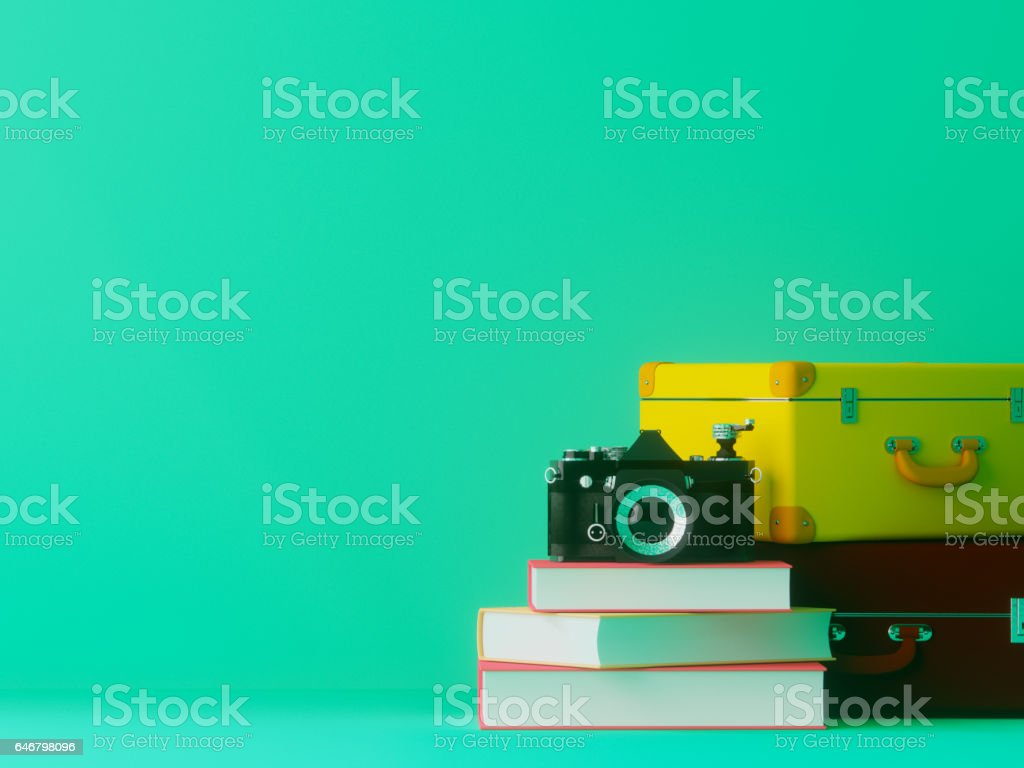 Camera and suitcase and book stock photo