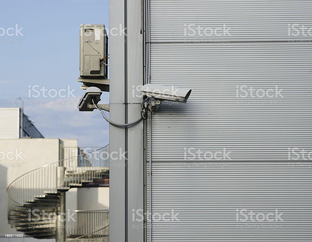 CCTV camera at the corner of building royalty-free stock photo