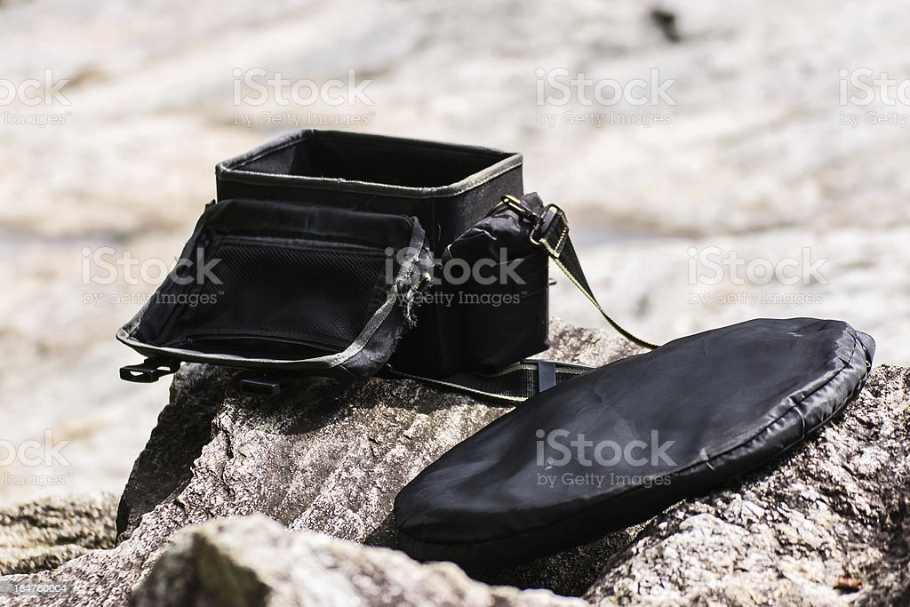 Camera bag And Reflection on Stone stock photo