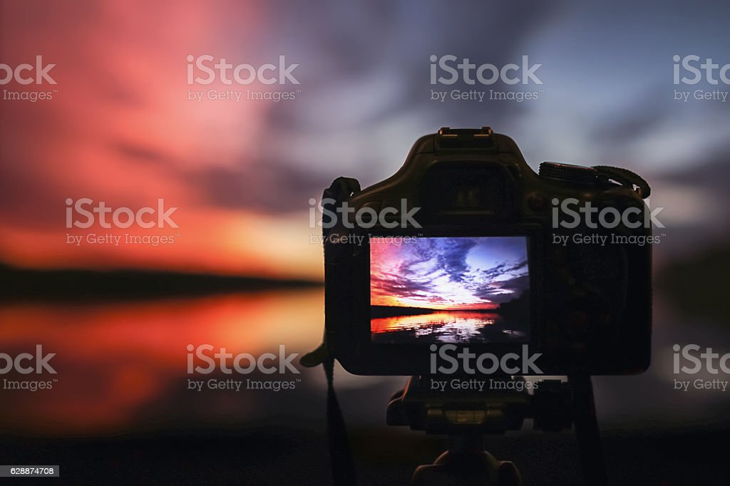 Camera capturing sunset. Photography view landscape. Camera the night view stock photo