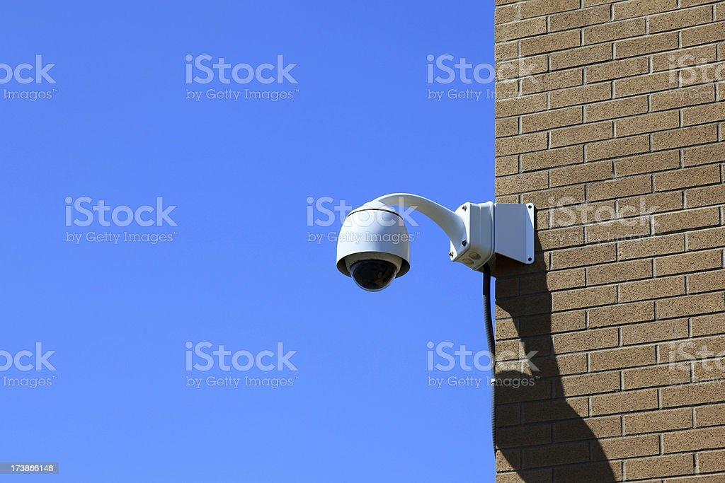 CCTV Camera Dome on Blue Sky Background royalty-free stock photo