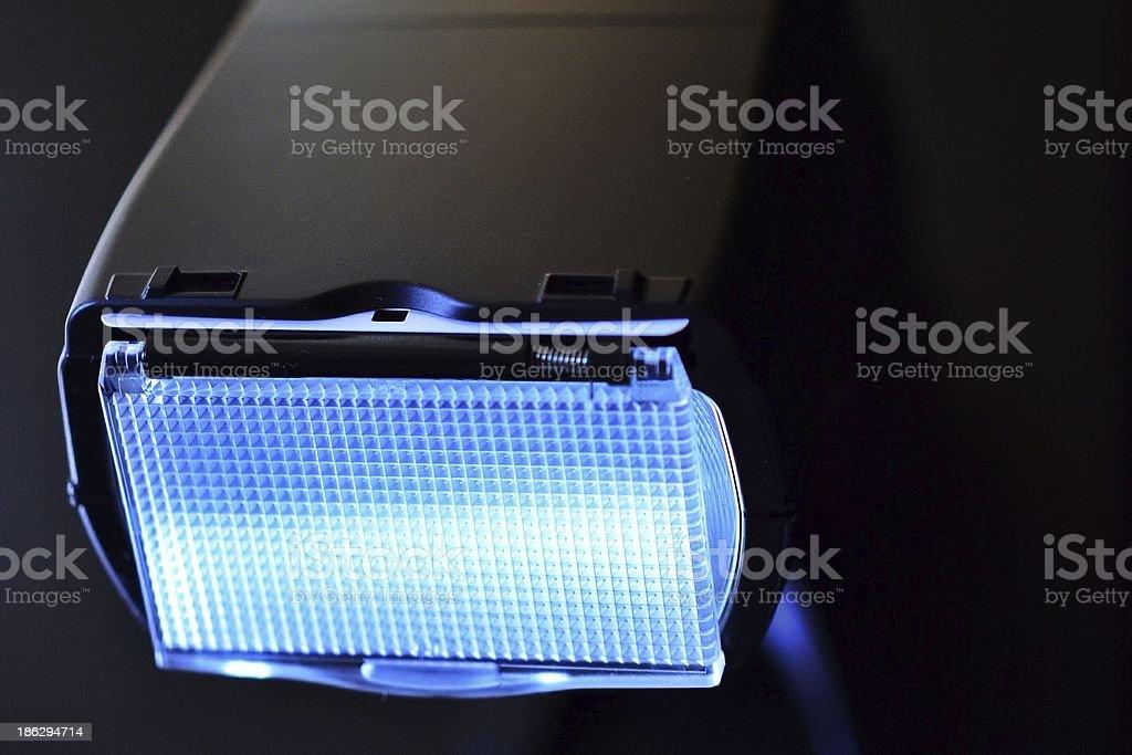 Camera flashgun or speed light. royalty-free stock photo