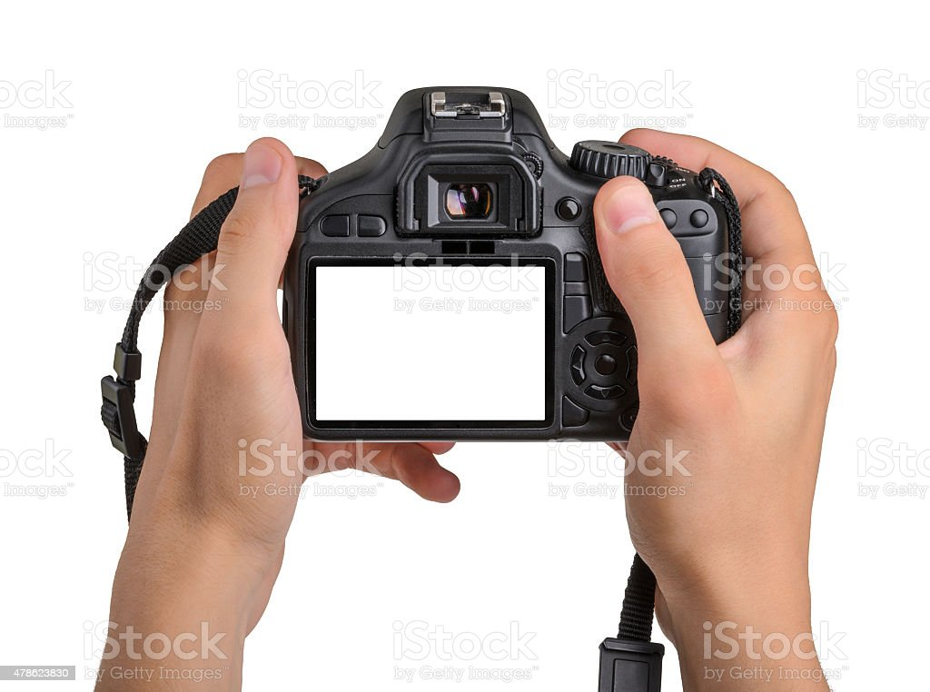 DSLR camera in hand isolated stock photo