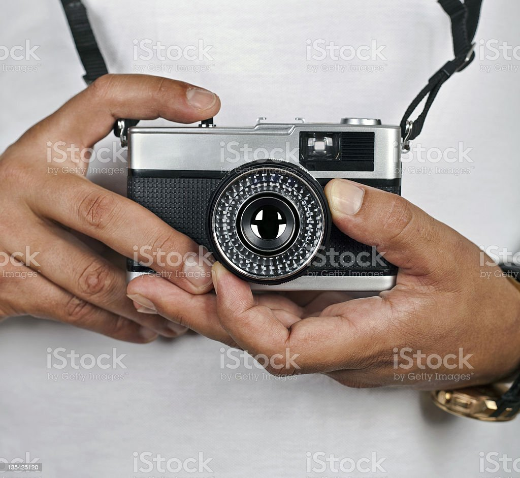 Camera in hand stock photo