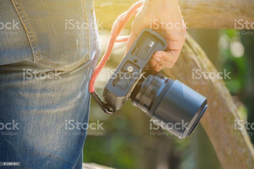 Camera in hand. stock photo