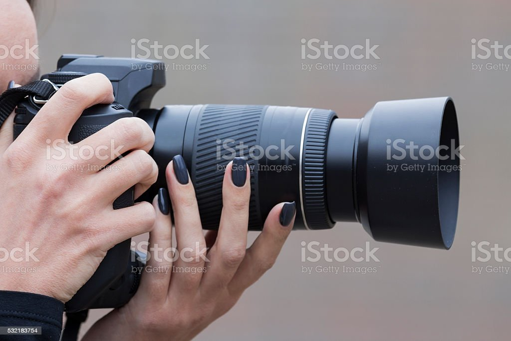 camera in the hands of girls stock photo