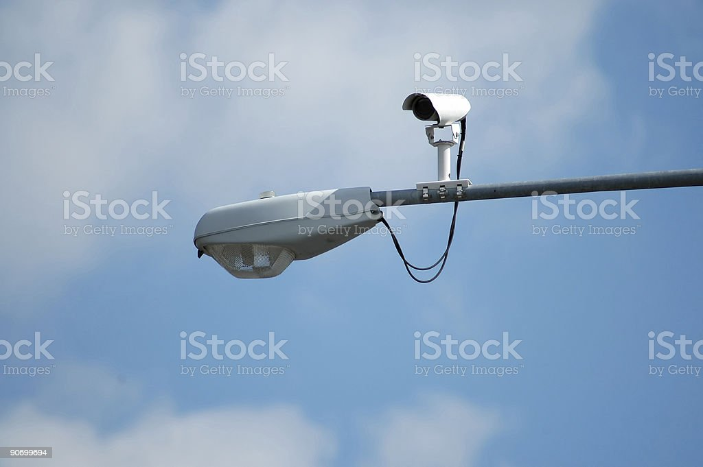 A camera installed on a streetlight watches traffic royalty-free stock photo