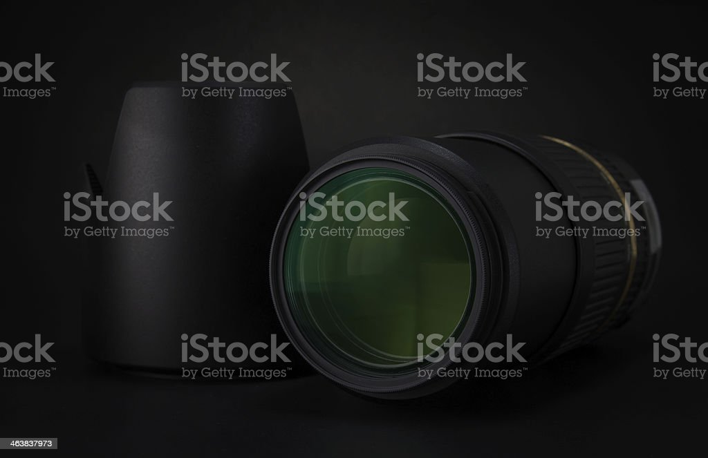 Camera len, filter, hood and lens cap royalty-free stock photo