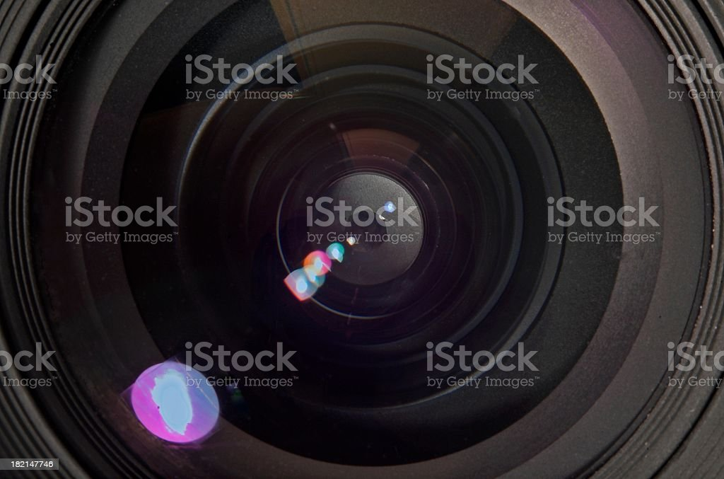 Camera lens aperture with refracted light stock photo