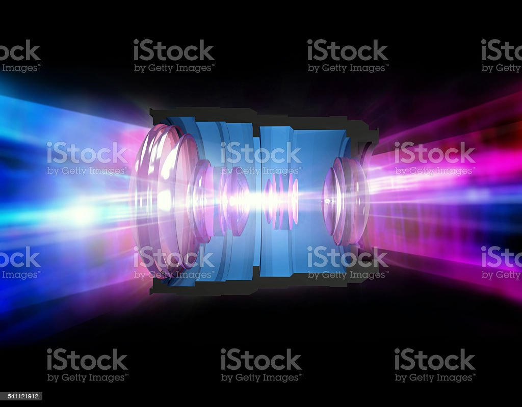 Camera lens cross section with light going through stock photo