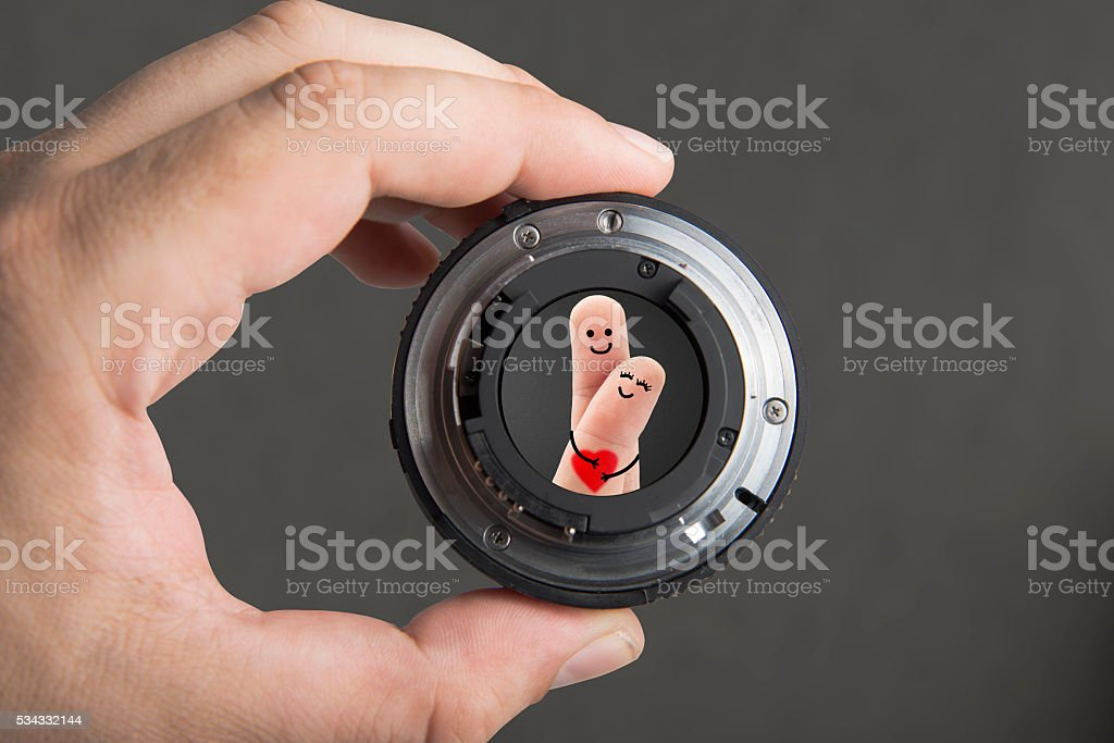 Camera Lens Focus On Finger Couple stock photo