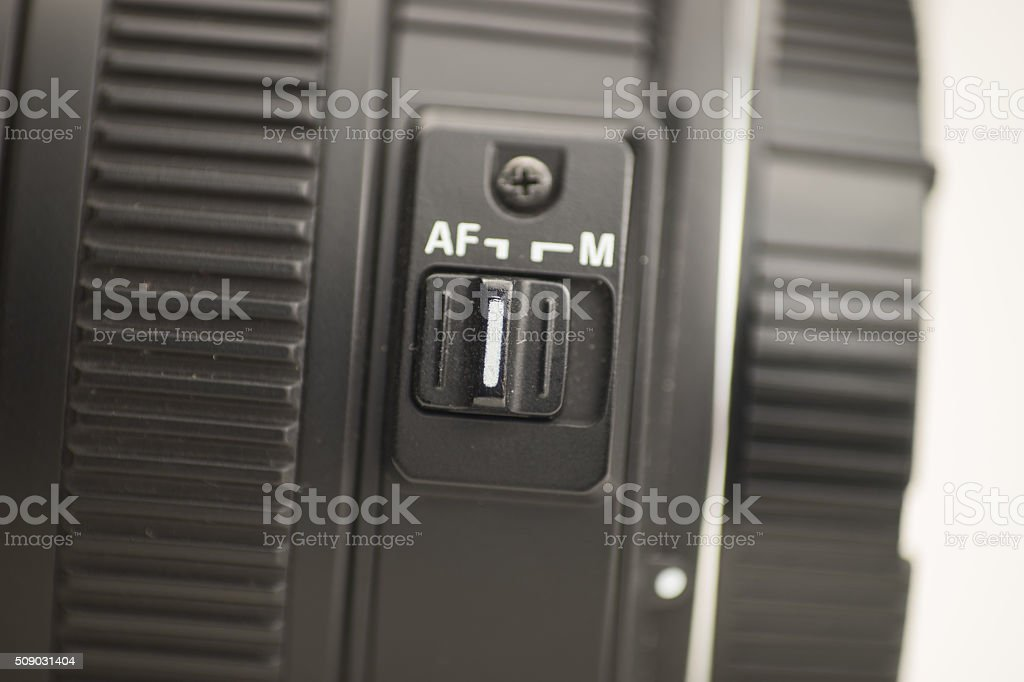 Camera lens manual focus (MF) / auto focus (AF) stock photo