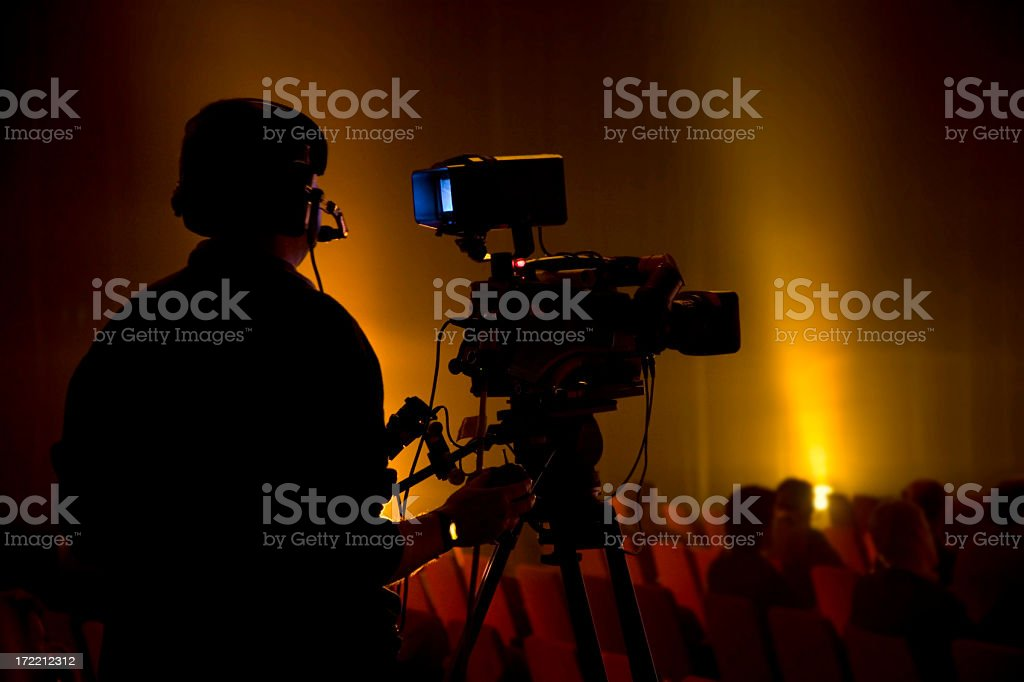 Camera man silhouette with audience stock photo