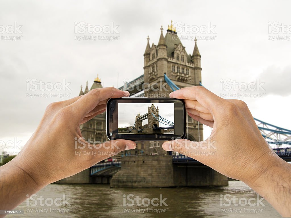 camera mobile at tower bridge royalty-free stock photo
