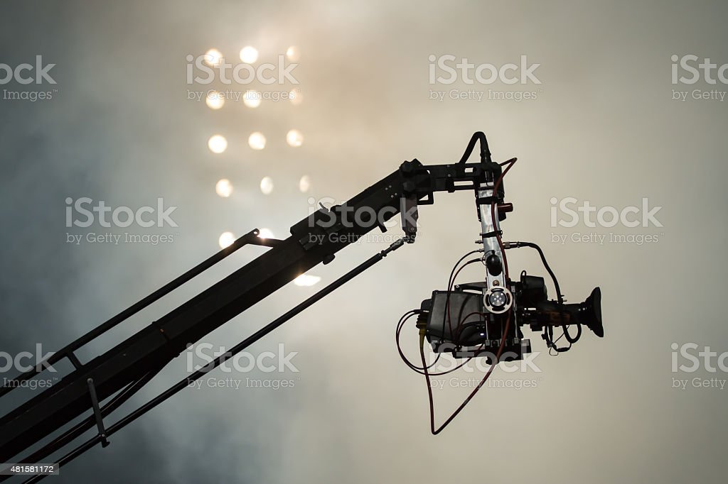 TV camera on a crane during football mach or concert stock photo