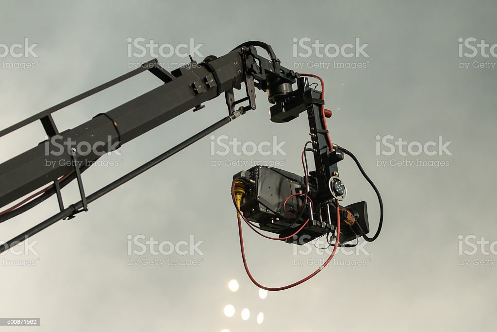 TV camera on a crane on football mach or concert stock photo