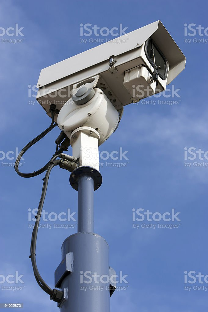 CCTV camera on cloudy blue sky royalty-free stock photo