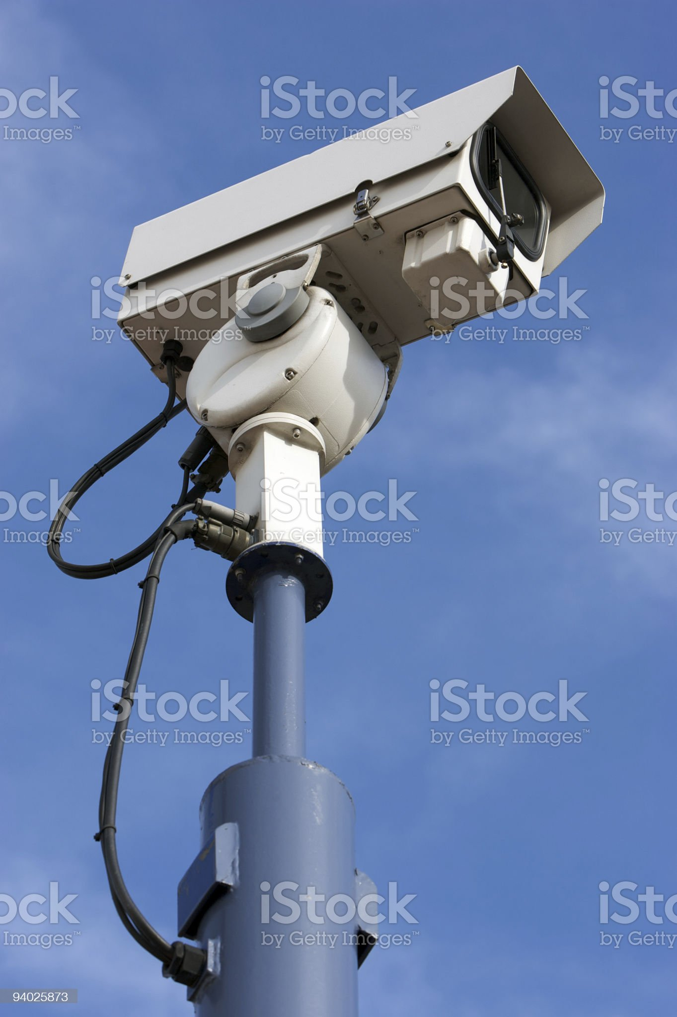 CCTV camera on cloudy blue sky royalty-free stock photo