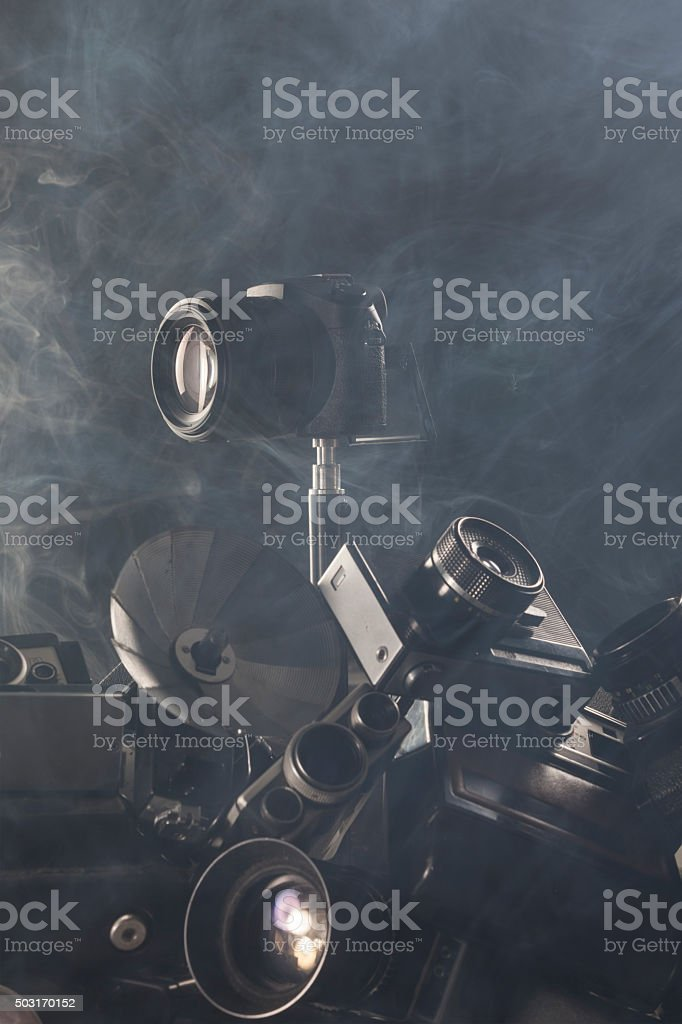 DSLR Camera On Top Of Antique Cams Heap stock photo