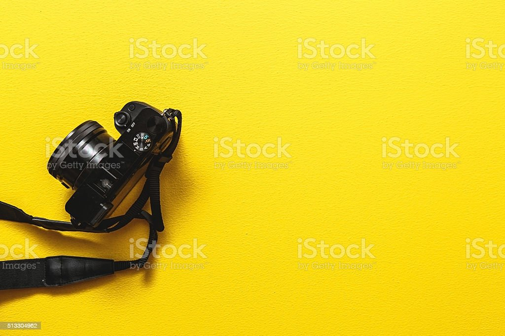 Camera on yellow background stock photo