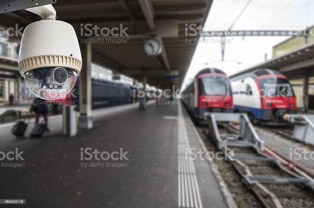 CCTV Camera operating in train station at platform stock photo