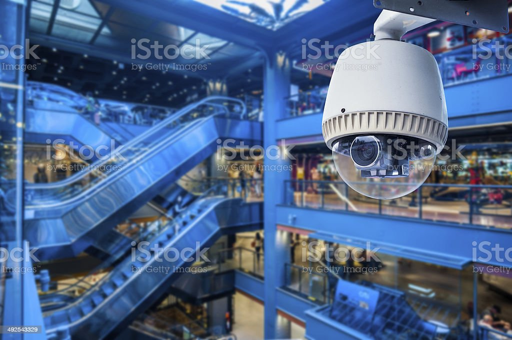 CCTV Camera Operating inside a station or department store stock photo