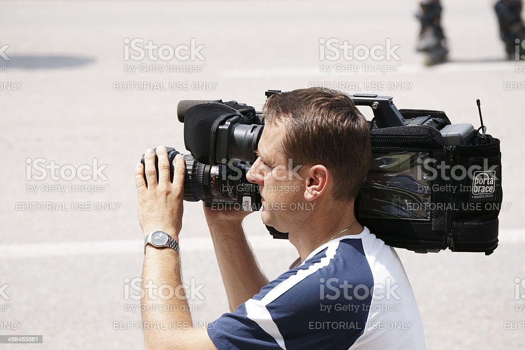 Camera operator with professional video-camera stock photo