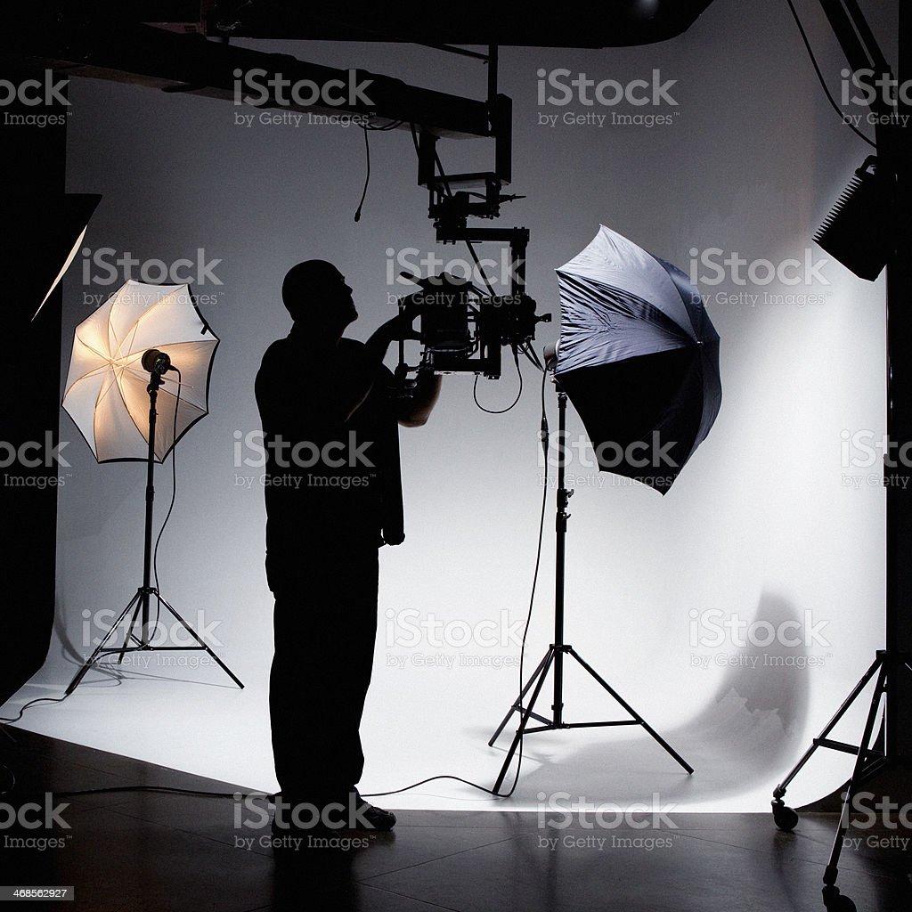 Camera Operator Working on Set royalty-free stock photo