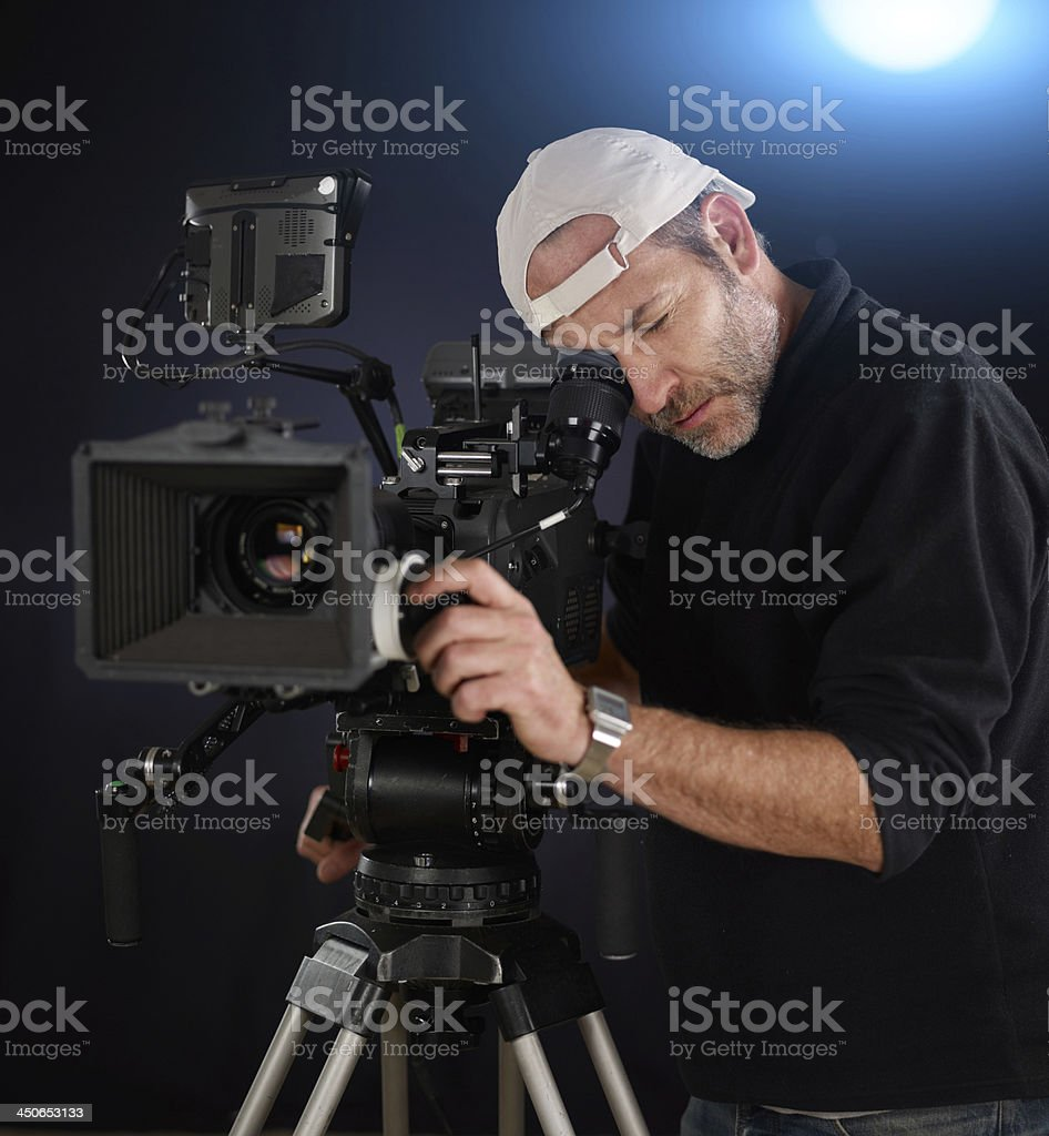 camera operator working with a cinemacamera stock photo