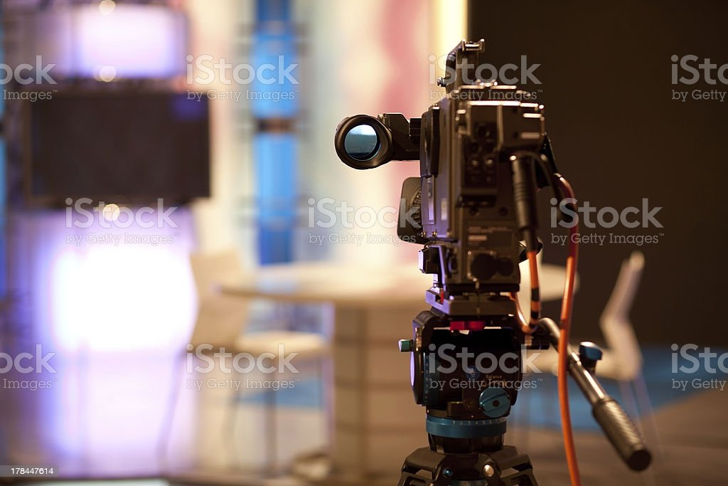 TV camera pointed at stage with unfocused background  royalty-free stock photo