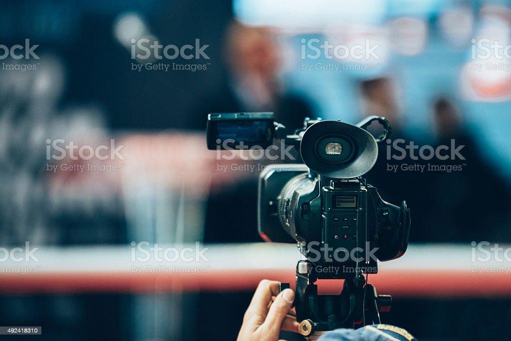 Camera recording an event stock photo