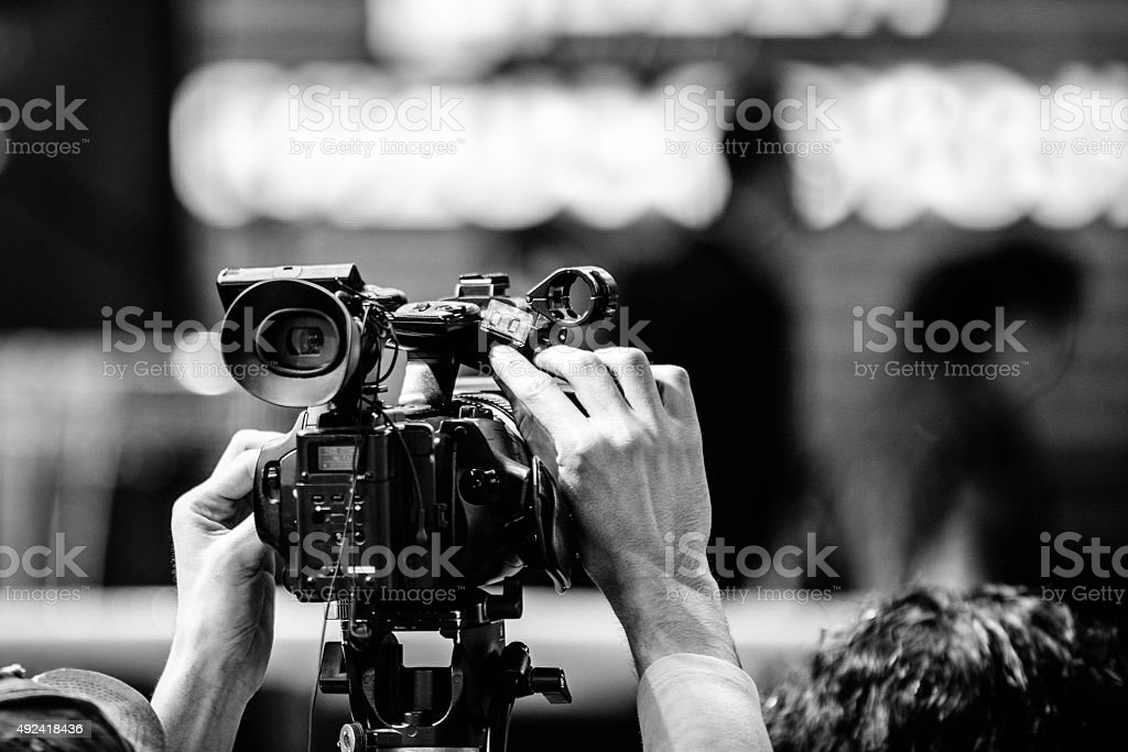 Camera recording an event stock photo