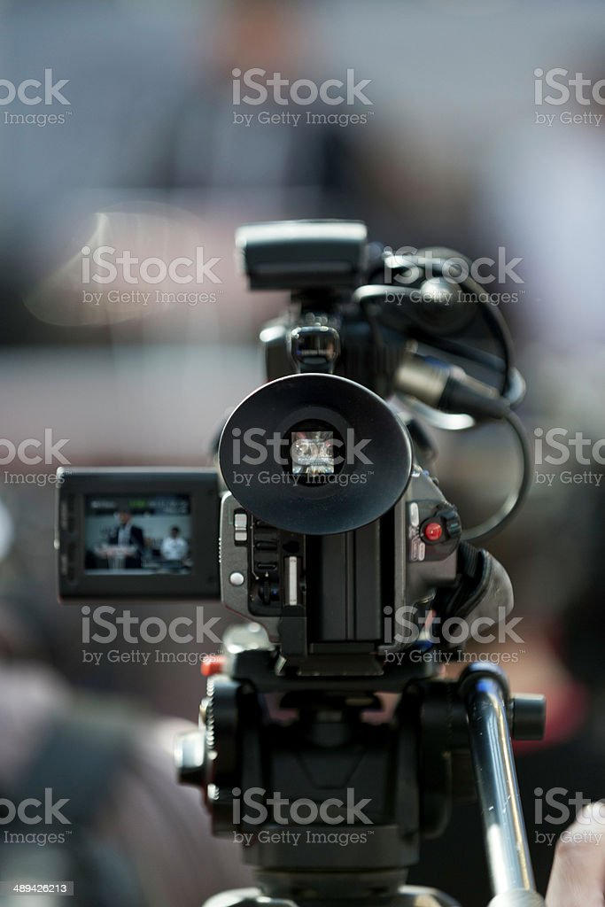 Camera recording publicity event stock photo