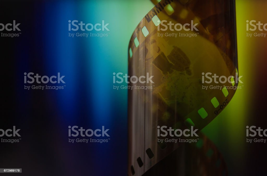 camera roll on rainbow background stock photo