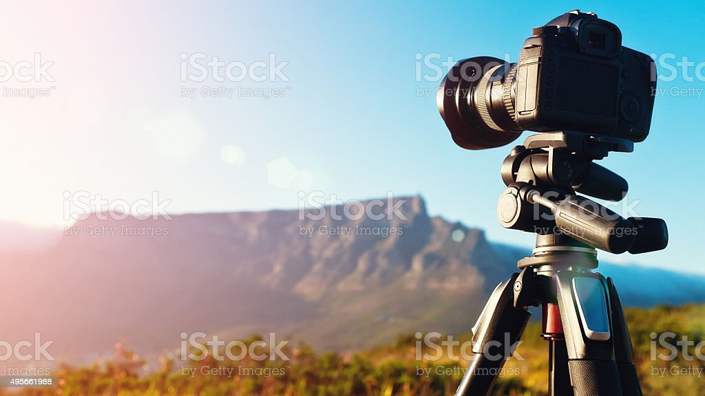 Camera shooting time-lapse video of Table Mountain at dawn stock photo