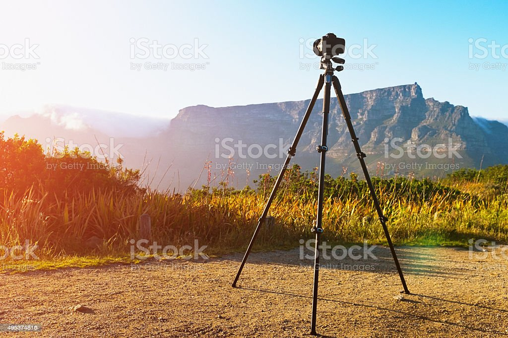 Camera  shooting time-lapse video sequence of Table Mountain at dawn stock photo