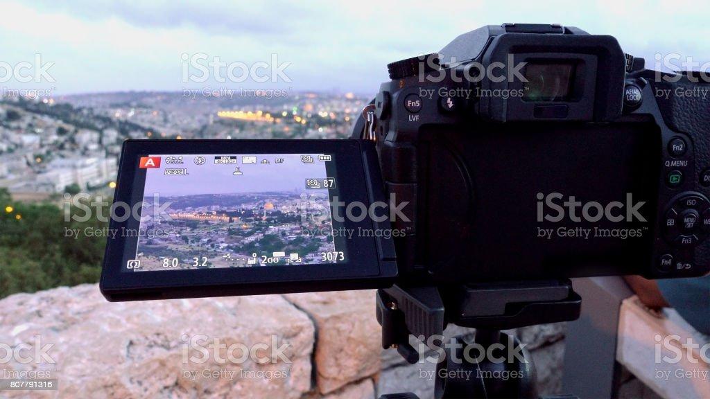 Camera shoots photo of the Jerusalem Old City stock photo