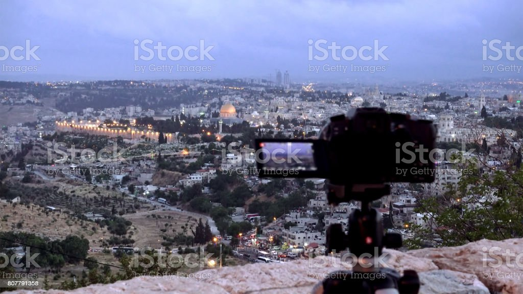 Camera shoots photo of the Jerusalem Old City stock photo