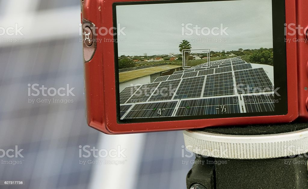 Camera takes a picture of a solar roof stock photo