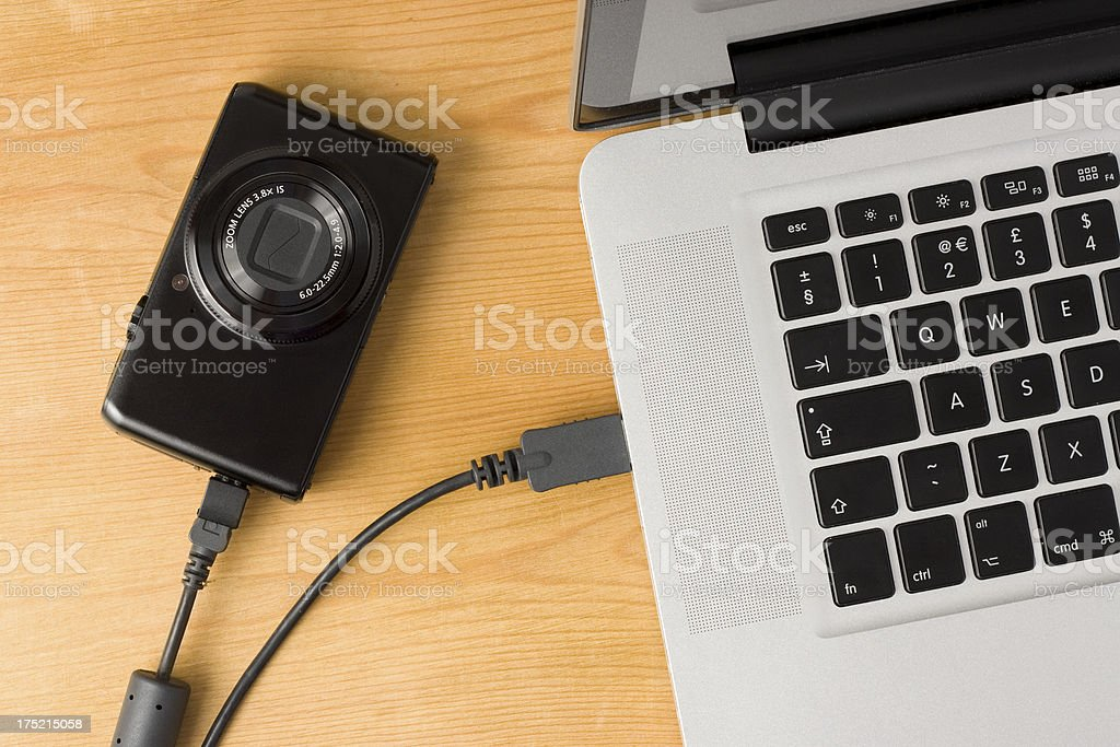 Camera to computer photo and video data transfer royalty-free stock photo