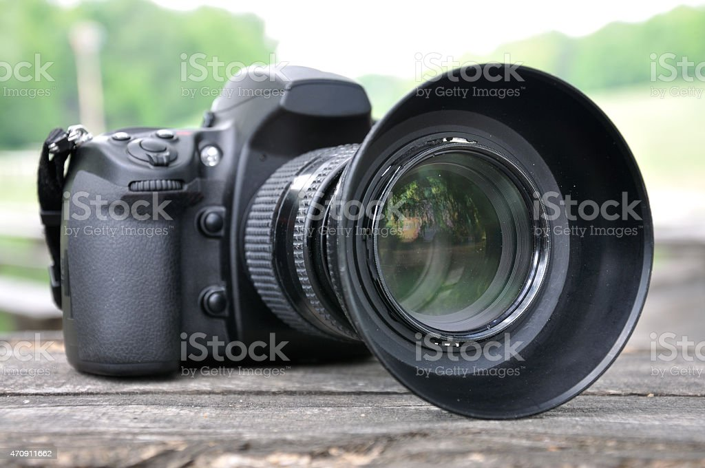 A DSLR camera with a large lens stock photo