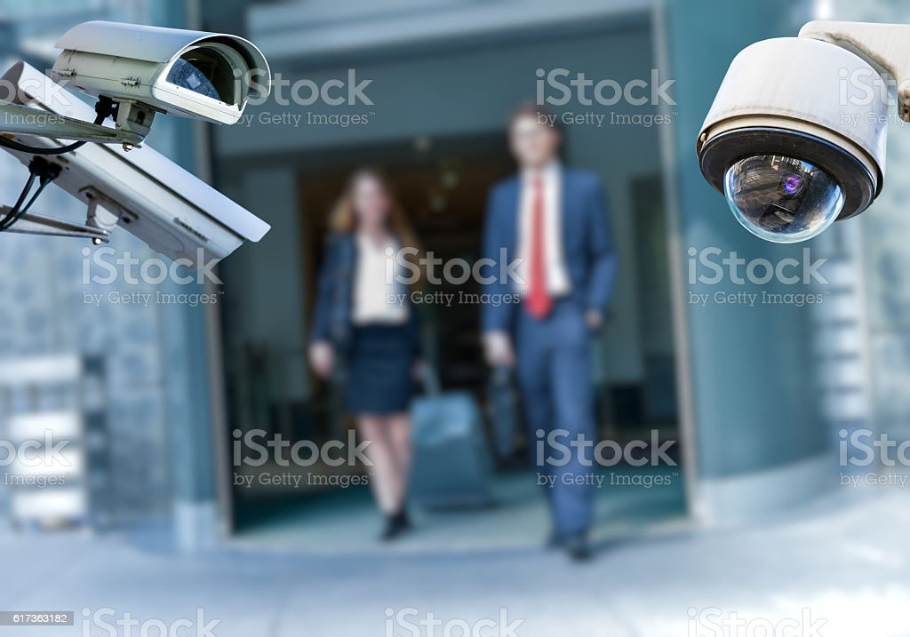 CCTV camera with airport area and people stock photo