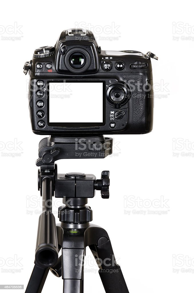 DSLR camera with blank screen on tripod isolated on white stock photo