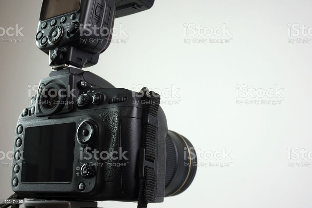 DSLR camera with external flash stock photo