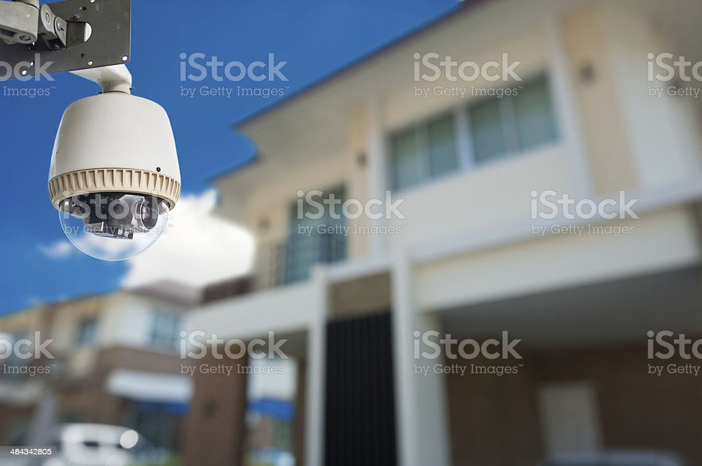 CCTV Camera with house in background stock photo