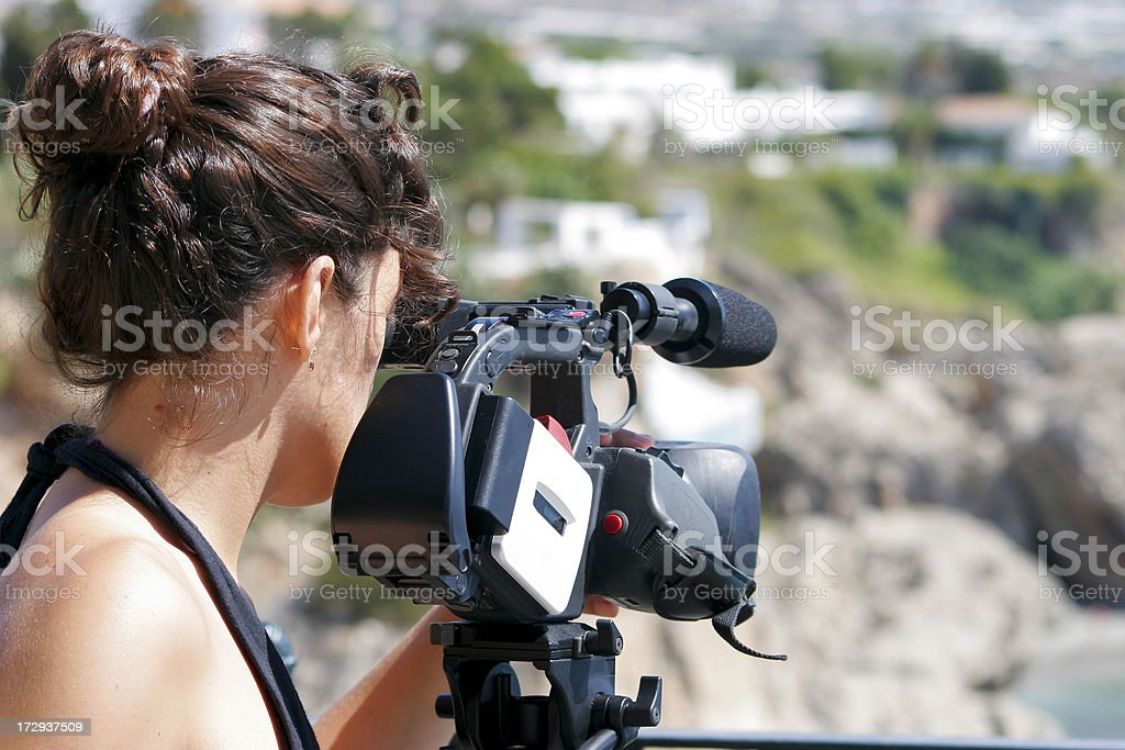 Camera woman in action stock photo